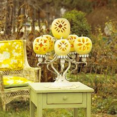 Make a pumpkin chandelier for a creative fall decoration. More pumpkin craft ideas:  http://www.bhg.com/decorating/seasonal/fall/pretty-pumpkins-for-fall/?socsrc=bhgpin092713pumpkinchandelier&page=7