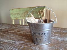 """Our """"Prayer Pail""""    Before dinner everyone in the family grabs a stick with a prayer request to pray for.  The easiest way we've found to teach our kiddos to pray for others!"""