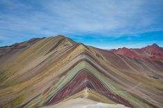 The most perfect place hidden deep in the Andes, the Rainbow Mountain Peru. An impossibly colorful mountain trek with Flashpacker Connect.
