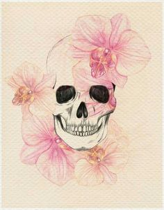 Skulls and Skeletons:  A Nice Skull Image with Flowers Around It.