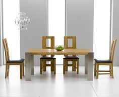 Sorrento 180cm Solid Oak and Metal Extending Dining Table with Lyon Chairs.
