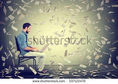 Young man using a laptop building online business making money dollar bills cash falling down. Money rain beginner IT entrepreneur success economy concept  - stock photo