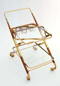 Italian Vintage Brass and Mahogany Bar Cart by Cesare Lacca   From a unique collection of antique and modern bar carts at https://www.1stdibs.com/furniture/tables/bar-carts/