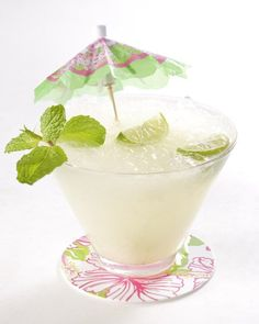 Key Lime Mojito ~ light rum, key limes, confectioners' sugar, club soda, mint leaves, ice