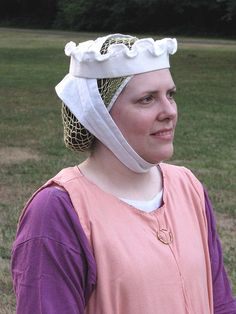 I like this headdress, except maybe without the ruffling on the top.