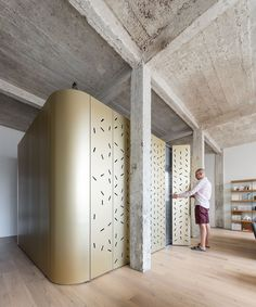 SABO project drops an aluminum island in a raw parisian loft