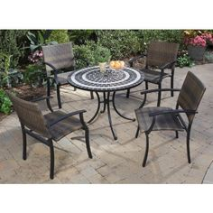 Home Styles Del Mar Five Piece Outdoor Patio Set with Arm Chair by Home Styles. $829.00. Black and gray tile top in a ringed pattern. Includes dining table and four arm chairs. Synthetic-weave seat and back. Adjustable, nylon glides prevent damage and provides stability. Enjoy some fresh air while taking a break with this five piece dining set with arm chairs. The group has a beautiful table top made with small, square and triangular, black and gray tiles in a ringed patter...