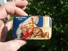 Blue Cross Tea sample tea tin ... small flat rectangular shape with scene of female warrior with shield and lion, early 20th century