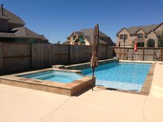 Lap pool with 12 in raised spa, tanning shelf and raised beam with 3 columns.
