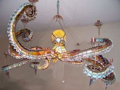 """Mason Parker of Mason's Creations has made a very cool stained glass octopus chandelier with detachable, light-up tentacles. """"This lamp measures approximately across. Each detachable tentacle has. Octopus Lamp, Octopus Tentacles, Octopus Decor, Octopus Design, Luminaire Original, Tadelakt, Cool Lamps, Deco Design, Chandeliers"""