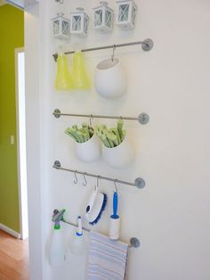 towel racks as hanging storage solution    contemporary laundry room by Atypical Type A