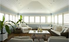 Sun room decorated in pale blue and white-Home and Garden Design Ideas