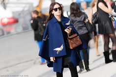 Miroslava Duma  uberchic in Valentino cape paired with Hermès suede Kelly bag | PFW Spring-Summer 2015 #StreetStyle