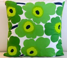 Floral Marimekko Pillow Cover. Handmade. Pattern: Unikko by Maija Isola. Green pillow, 20x20 inches (50x50cm) by PantsandPillows on Etsy https://www.etsy.com/listing/229827497/floral-marimekko-pillow-cover-handmade