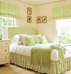 Lovely fresh Roman blinds in this pretty bedroom.