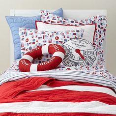 Land of Nod Nautical Bedding.  Much too theme-y for me, but I love the red and white stripe.