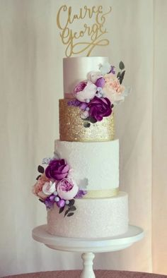 This Beautiful four tier blush wedding cake with gold accents and deep red flowers is perfect for autumn wedding - Choosing a wedding cake may seem like one of those minor details to take care of during your wedding planning Beautiful Wedding Cakes, Beautiful Cakes, Dream Wedding, Gold Wedding Cakes, Flower Wedding Cakes, Wedding Cake Purple, White And Gold Wedding Cake, Textured Wedding Cakes, 50th Wedding Anniversary Cakes