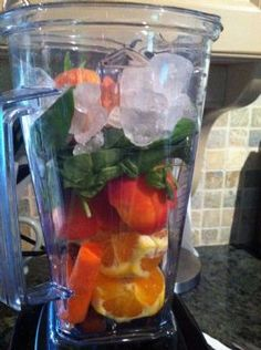 Favorite Vitamix smoothie - Orange, Baby Spinach, Banana, Red Grapes - frozen, Carrot, frozen Pineapple, frozen Peach, Apple, Vanilla protein powder (optional)