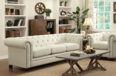 50455SC Set Including Sofa and Chair with Button Tufted Detailing, Turned Bun Feet, Nail Head Accents and Rolled Arms in Cream