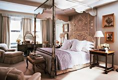 A canopy style bed and vanity add a princess-esque feel to this ornate bedroom.