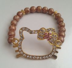 Gold Hello kitty bling bracelet with golden brown by KatellaDee, $10.00