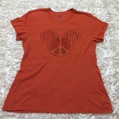 Orange Disneyland Mickey Shirt, Size XL Official Disney gear! Only worn once to Disneyland and not worn again after. Soft cotton material make the shirt comfortable to wear. Perfect for any Disney trip!                           Measurements                                                        Bust:  Approximately 42 inches                   Length: 25.5 inches Disney Tops Tees - Short Sleeve