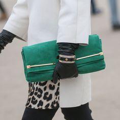 Green suede clutch, white coat and leopard peeking through.  Paris Fashion Week, Fall 2013.