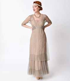 A sweet dreamy dress for a romantic night! A passionate Edwardian era gown in delicate beige tulle with soutache embroidered stitching and pintucking over a soft beige crepe slip with a longer hem for a graceful tiered effect. The sultry scalloped scoop n