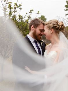 This swooping veil photo of this bride and groom is PERFECTION! MKM Photography, a Durham North Carolina photography business, captures the love and tenderness shared by these newlyweds beautifully.
