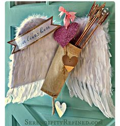 Gorgeous Cupid's wings and bow and arrows door decor from www.SerendipityRefined.com