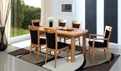 The Royal collection designed by Klose. Wood dining tables and chairs to charm the dining area. #KloseFuniture #WoodenFurniture #chairs #diningtable
