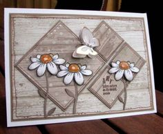 Biggan, splitcoaststampers.com shares her beauty of a card with daisies, diamonds and butterfly.