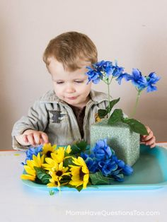 Spring Tot School Trays: Stick fake flowers in a block of Styrofoam.