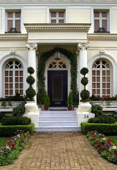 beautiful entry, topiaries are perfect