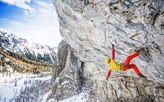 Rock climber Gaetan Raymond climing in the Dolomites near Marmolada, Italy