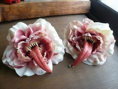 <3 really like these. could make a bouquet of them for a creepy centerpiece.