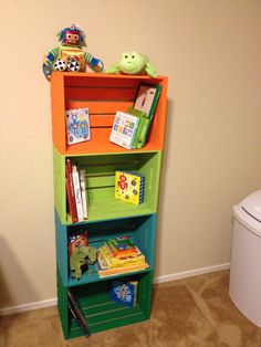 DIY wooden Crate Book Shelf for kids room.  I only used one crate on the floor so the little one would not pull it over.  Painted mine in purple and it fits a LOT of books!!  Love it!!