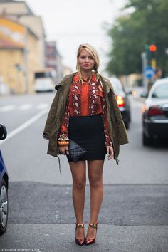 Veronica Ferraro in the olive army jacket, python printed shirt, black skirt and combined heels.