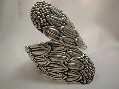 Clamper Cuff | Alfredo Villisana. Sterling silver.  ca. 1960/70.  Very similar to the famous cornflower bracelet by Margot de Taxco.