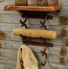 I love the wall behind and the horseshoe towel rack! And easy to do with old horse shoes!
