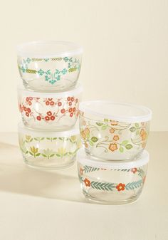 <p>Your weekend picnics and park-side lunch breaks are even more picturesque when each snack and treat is packed in one of these charming containers. Garnished with floral motifs in gleeful, springy tones, these 16-ounce glass bowls are a refreshing complement to your culinary skills and outdoor setting. Just fill each petite storage container with your favorite dish, pop on the included flexible lids, then set off with this collection of five planted beside the blanket in your trusty b...