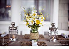 love the twine around the centerpiece + lanterns