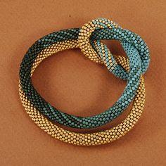 "Bracelet, ""Weaver's Knot"", Cylindrical   Glass Miyuki Beads. I never considered the Miyukis in this way before."