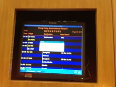 Windows Update in progress on primitive LCD based FIDS system in QANTAS First Class Lounge Hong Kong airport