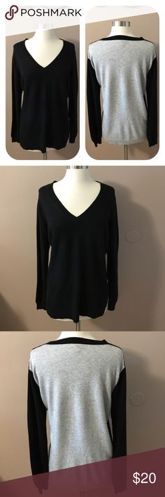 """J Crew Black /Gray V Neck Sweater Black front , light gray back , with a v neck and 2.25"""" side slits . Long sleeves. Feels like a lightweight wool but I'm not sure because the fabric content tag has been removed. Slight underarm piling. 26"""" shoulder to bottom. 20"""" armpit to armpit, J. Crew Sweaters V-Necks"""