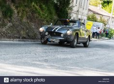 Download this stock image: FERRARI 250 GT COUPÉ 1956 on an old racing car in rally Mille Miglia 2017 the famous italian historical race (1927-1957) on May 19 2017 - KB5GRW from Alamy's library of millions of high resolution stock photos, illustrations and vectors.