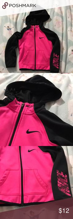 XS Nike Dri-Fit zip-up jacket with hood This pink and black zip-up dri-fit jacket with a hoodie is perfect for active kids! My daughter hardly wore it, but there are two little black marks on the front as shown in the last picture. Nike Jackets & Coats