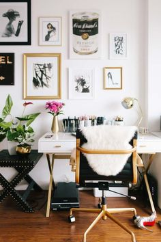 Chic home office. Black desk chair with gold accents. White laquer desk with gold accents and a gallery wall.