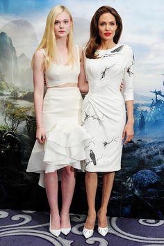 Elle Fanning and Angelina Jolie at a Maleficent Press Conference, white crop top and skirt, white dress with bird print