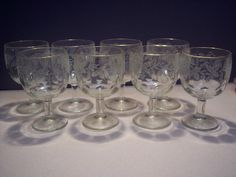 She didn't make it that often but when she did Mam-Maw served her sweet,sweet, sweet iced tea in goblets like these. The ones we had at home were plain and undecorated.Vintage Bartlett Collins Clear Etched Glass Thumbprint Water Wine Goblets | eBay